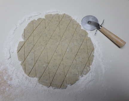 Roll out the shortbread dough to about a half inch thick. Score the dough with a sharp knife or pizza cutter to form diamonds (shown) or any other shape you want.